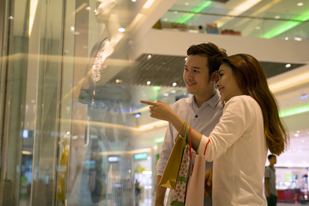 Young Asian happy couple shopping
