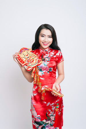 congratulate: Happy Chinese new year. Asian woman with gesture of congratulation Stock Photo
