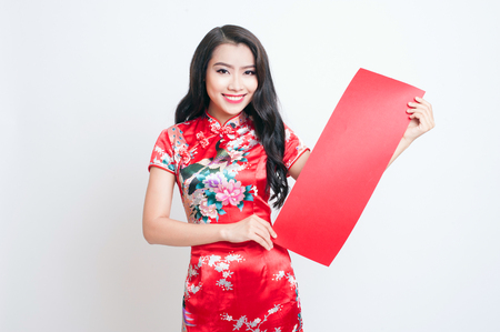 chipao: Happy Chinese new year. Asian woman with gesture of congratulation Stock Photo