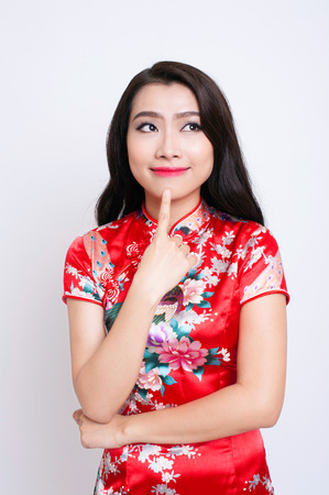 chinese lady: Happy Chinese new year. Asian woman with gesture of congratulation Stock Photo
