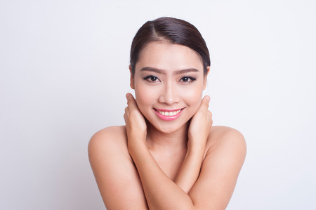 sad face: Attractive asian woman skin care image