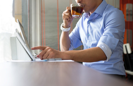business casual: Asian casual business man working in coffee shop Stock Photo
