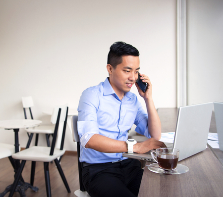 casual business man: Asian casual business man working in coffee shop Stock Photo
