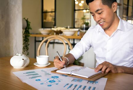 adult vietnam: Asian casual business man working in coffee shop Stock Photo