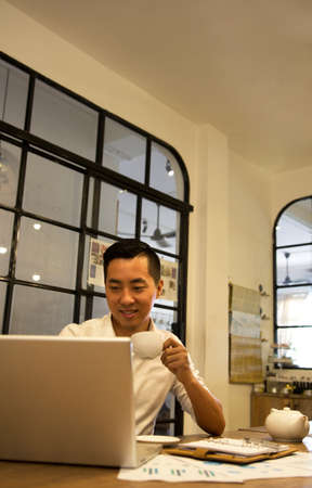 asian business man: Asian casual business man working in coffee shop Stock Photo