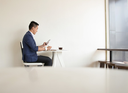 business man phone: Asian casual business man working in coffee shop Stock Photo