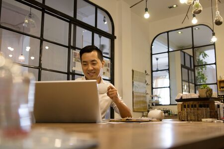 asian adult: Asian casual business man working in coffee shop Stock Photo