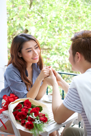 adult vietnam: Asian romantic young couple enjoy Valentine with roses flowers Stock Photo