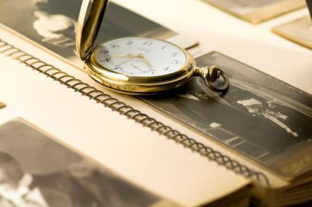 old photo album: Old photo album and pocket watch
