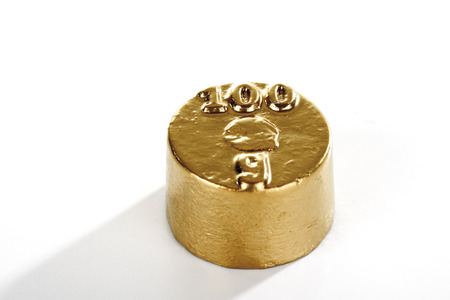 calibrated: Golden hundred grams weight