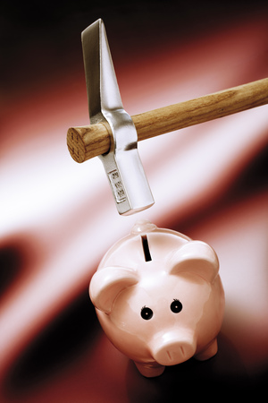 elevated view: Piggy bank with hammer above, elevated view Stock Photo