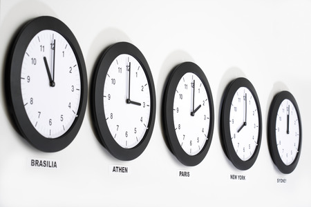greenwich: Clocks on wall, symbol for Greenwich Mean Time Stock Photo