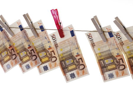 50 Euro bank notes hanging on clothesline photo