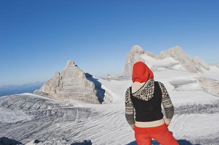 steiermark: Austria, Steiermark, Dachstein, Young woman standing on mountain, rear view
