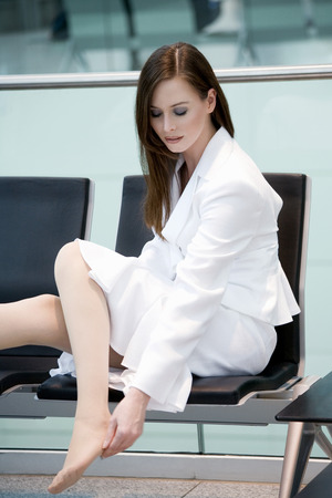 business woman legs: Business woman sitting in waiting hall