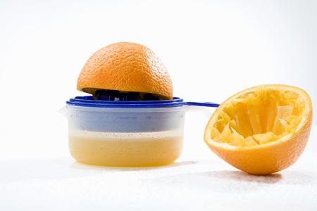 squeezer: Orange on squeezer Stock Photo