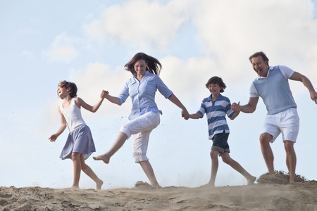 cute guy: Germany, Family holding hands and playing together
