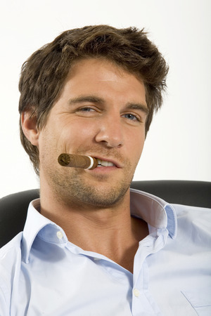 supercilious: Young man with cigar, portrait