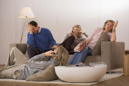 Family sitting in living room photo
