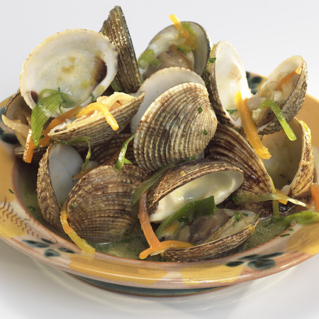 molluscs: Clam shells in white-wine sauce and root vegetables Stock Photo