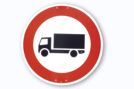 Road sign, motor lorry, close-up photo