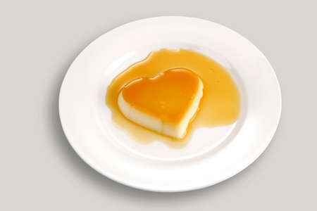 elevated view: Heart-shaped creme caramel, elevated view Stock Photo