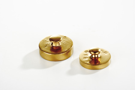 calibrated: Two golden weights Stock Photo