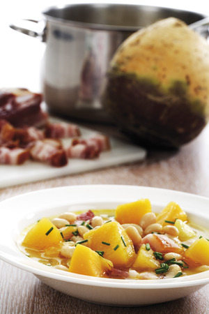 rutabaga: Rutabaga vegetable soup with beans and bacon, rutabaga korm, bacon and pot in background