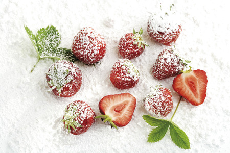 Strawberries with icing sugar, close-up Stock Photo