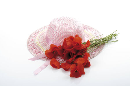 girlish: Light pink girlish summer hat and a bunch of poppies Stock Photo