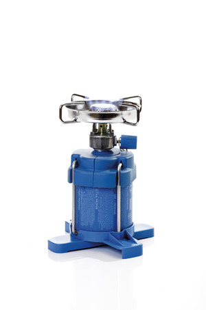 Lit camping stove with butane flame photo