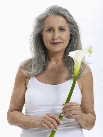 senior woman holding flower, portrait