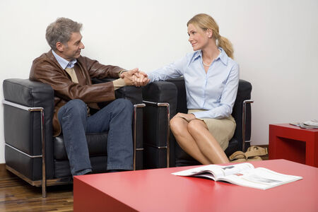 Couple sitting in the waiting room