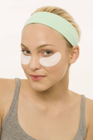 Young woman with eye treatment mask portrait Stock Photo