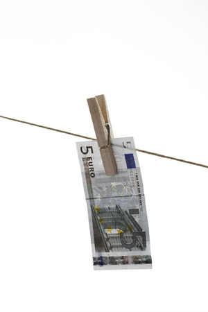 5 Euro bank notes hanging on clothesline photo