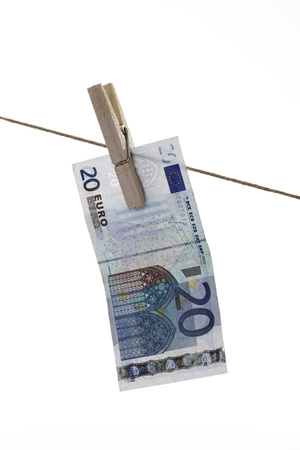 20 euro: 20 Euro bank note hanging on clothesline