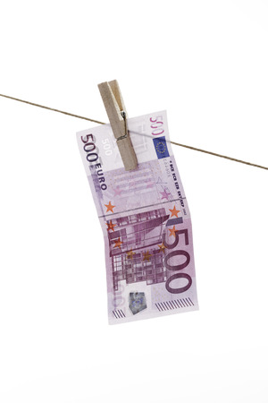 500 Euro bank note hanging on clothesline photo