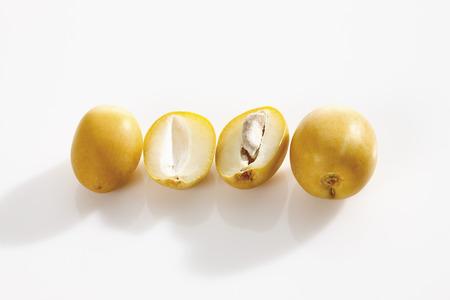 Fresh whole and sliced dates (Phoenix dactylifera)