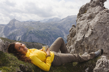 Austria, Salzburger Land, young woman relaxing photo