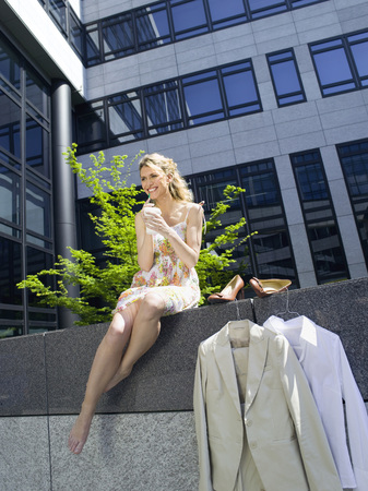 Young businesswoman taking a break drinking coffee low angle view