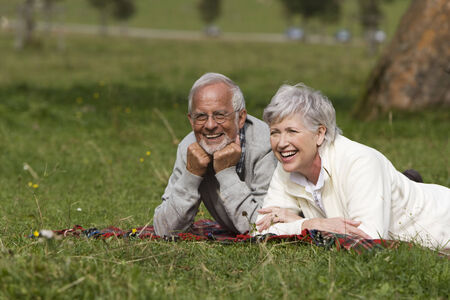 Austria, Karwendel senior couple relaxing in meadow photo
