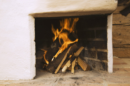 Log fire in fireplace close-up photo