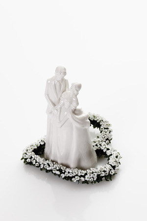 bridal couple: Bridal couple figurine standing on heart of flowers