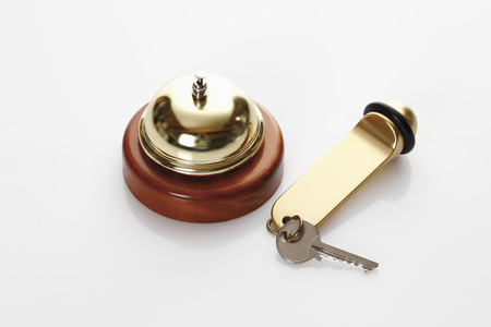 service bell: Hotel key and service bell Stock Photo