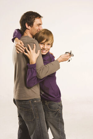 Father and son  embracing, Man holding bike key photo