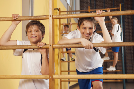 wall bars: Boy and girls climbing wall bars Stock Photo