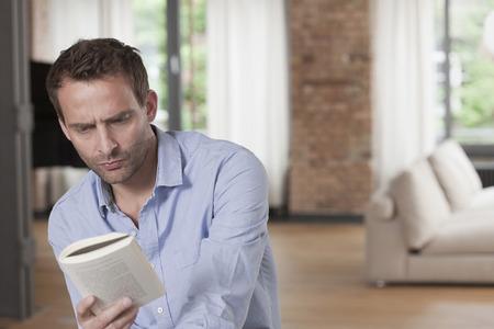 coziness: Germany, Man reading book  Stock Photo