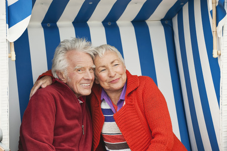 Germany North Sea St.Peter-Ording senior couple sitting on hooded beach chair photo