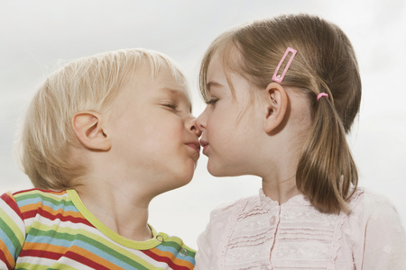 rubbing noses: Germany, Cologne, Children rubbing noses Stock Photo