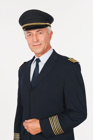 airline pilot: Close up of senior flight captain on white background
